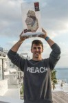 "Aleksandar Baiturin of Russia poses for a portrait with his trophy (mans the best trick) after the finals at the ""Red Bull Art of Motion"" freerunning competition on Santorini Island, Greece on October 4, 2014. // Predrag Vuckovic/Red Bull Content Pool // P-20141004-00241 // Usage for editorial use only // Please go to www.redbullcontentpool.com for further information. //"